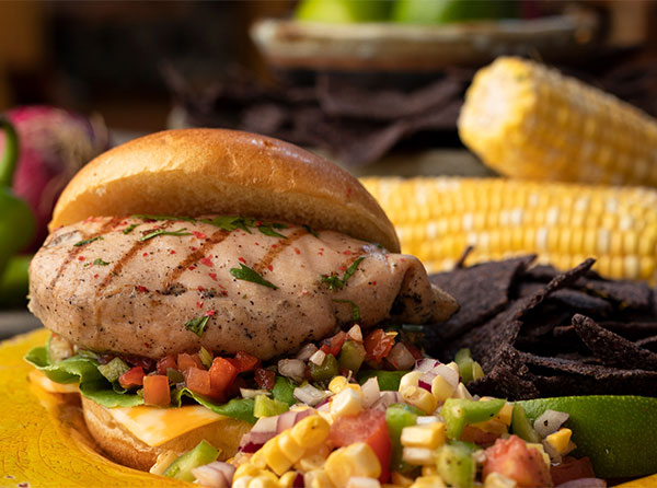 Fresca Grilled Chicken Sandwich with Tortilla Chips and Pineapple Corn Salsa